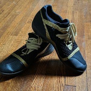 Black and gold pumas men's 9.5